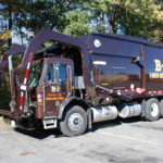 Side view of a frontal load truck from B-P Trucking, Inc. dumpster rental in Ashland, MA