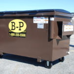Two-yard container with wheels from dumpster rental company B-P Trucking, Inc. in Ashland, MA