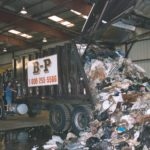 A dumpster truck dumping a load of paper products at one of the facilities for B-P Trucking, Inc. in Ashland, MA