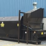 Side view of a dumpster rental from B-P Trucking, Inc. in Ashland, MA