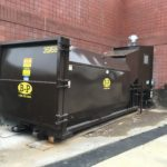 Trash compactor loaned by B-P Trucking, Inc. recycling services in Ashland, MA
