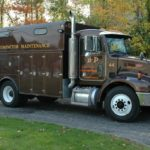 A semi-truck used for compactor maintenance from B-P Trucking, Inc. in Ashland, MA