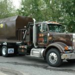 Front view of a roll-off truck from B-P Trucking, Inc. recycling services in Ashland, MA